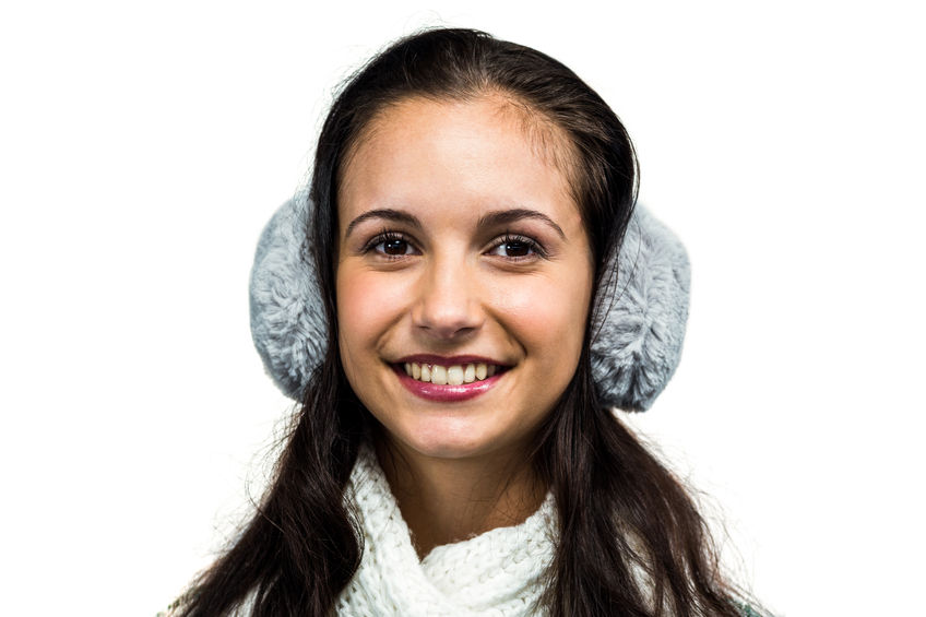 49031307 - smiling woman with earmuffs on white screen