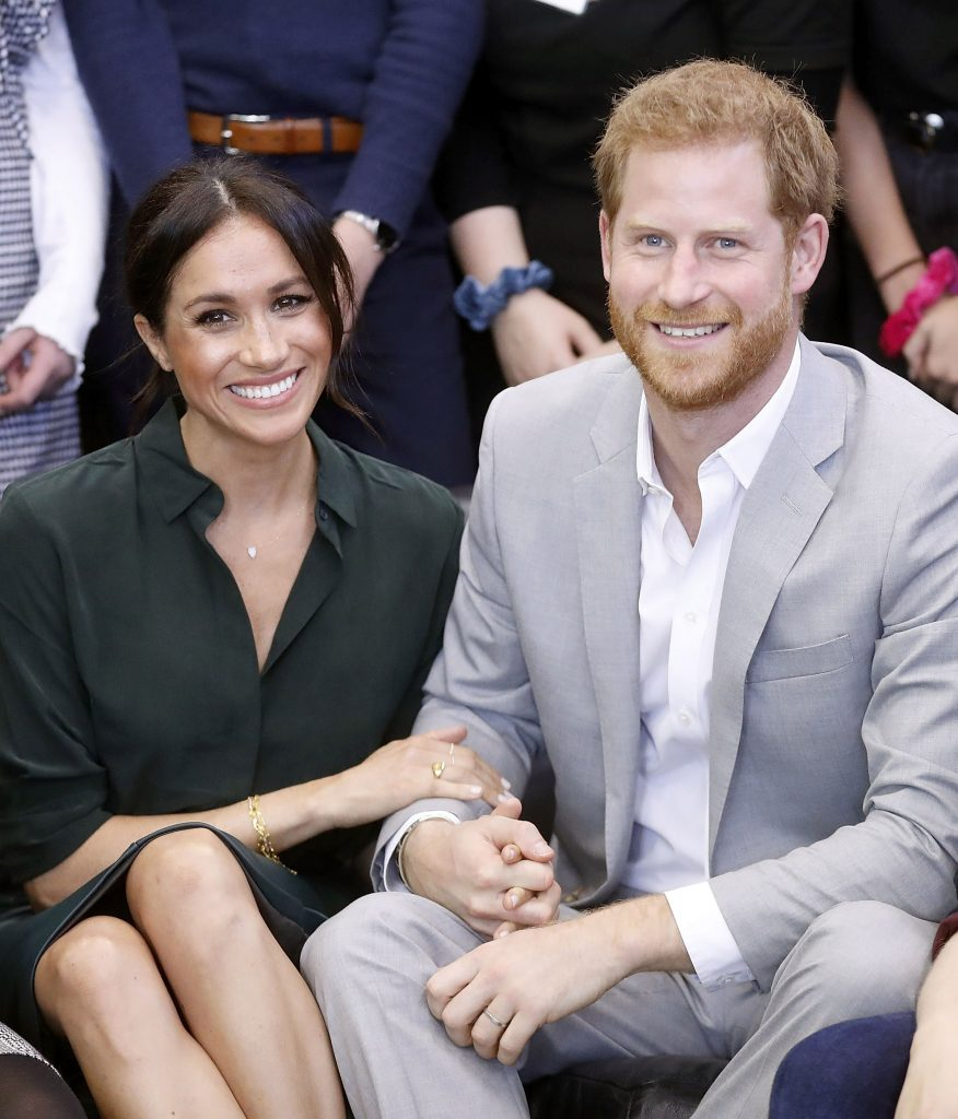 Gestul subtil pe care îl face Meghan Markle de câte ori apare în public cu prințul Harry